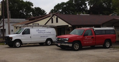 Bryant Heating and Cooling Vehicles in front of the shop, Canton Ohio.